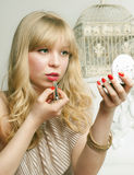 Pretty blonde tint the lips Stock Photography