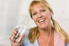 Pretty Blonde with Towel Drinking Water Bottle Stock Photo