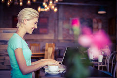 Pretty blonde using laptop computer Stock Photography