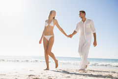 Pretty blonde walking away from man holding her hand Stock Image