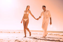 Pretty blonde walking away from man holding her hand Royalty Free Stock Image
