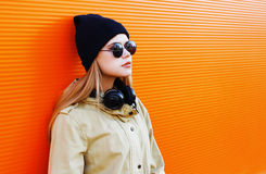 Pretty blonde wearing a black hat and headphones Stock Image