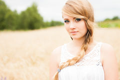 Pretty blonde in a wheat field Royalty Free Stock Image