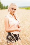Pretty blonde in a wheat field Stock Images