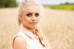 Pretty blonde in a wheat field Royalty Free Stock Photos
