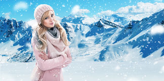 Pretty blonde with white mountains in the background. Pretty blond lady with white mountains in the background Stock Photo