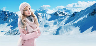 Pretty blonde with white mountains in the background. Pretty blond lady with white mountains in the background Royalty Free Stock Photo
