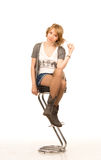 Pretty blonde woman on a bar stool Royalty Free Stock Photography