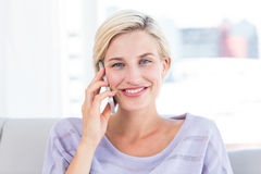 Pretty blonde woman calling on the phone Royalty Free Stock Image