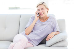 Pretty blonde woman calling on the phone Royalty Free Stock Photo