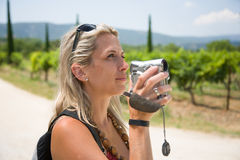 Pretty blonde woman with camcorder in provence Stock Images
