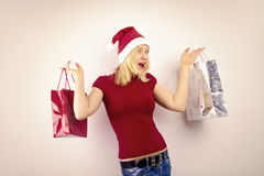Pretty blonde woman with christmas present Royalty Free Stock Photos
