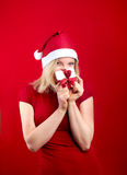 Pretty blonde woman with christmas present Royalty Free Stock Image