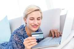 Pretty blonde woman doing online shopping Royalty Free Stock Images