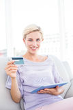 Pretty blonde woman doing online shopping Stock Images