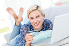 Pretty blonde woman doing online shopping Stock Photos