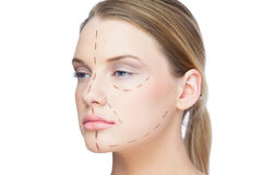 Pretty blonde woman with dotted lines on the face Stock Photos