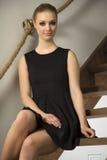 Pretty blonde woman in elegance fashionable dress Stock Photos