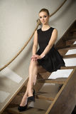 Pretty blonde woman in elegance fashionable dress Royalty Free Stock Photos