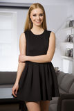 Pretty blonde woman in elegance fashionable dress Stock Images