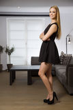 Pretty blonde woman in elegance fashionable dress Royalty Free Stock Image