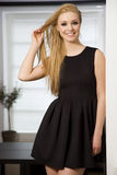 Pretty blonde woman in elegance fashionable dress Royalty Free Stock Photography