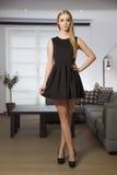 Pretty blonde woman in elegance fashionable dress Stock Photo