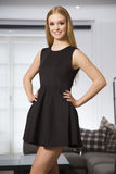 Pretty blonde woman in elegance fashionable dress Stock Photography