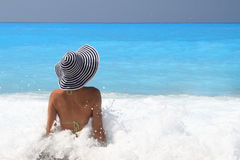 Pretty blonde woman enjoying the Ionian sea Royalty Free Stock Photos