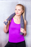 Pretty blonde woman after fitness training Royalty Free Stock Photo
