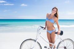 Pretty blonde woman going on a bike ride Stock Photo