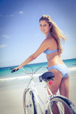 Pretty blonde woman going on a bike ride Royalty Free Stock Image