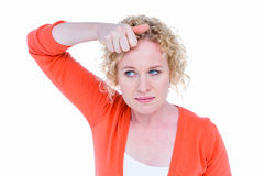 Pretty blonde woman with hand in hair Stock Images