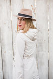 Pretty blonde woman with hat looking over her shoulder Stock Photo