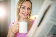 Pretty blonde woman having coffee Stock Images