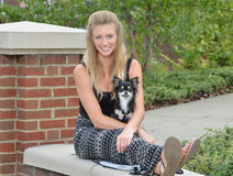 Pretty blonde woman with her pet Chihuahua Royalty Free Stock Photos