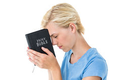 Pretty blonde woman holding bible Royalty Free Stock Photos