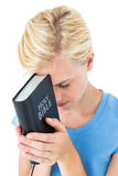 Pretty blonde woman holding bible Royalty Free Stock Images