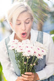 Pretty blonde woman holding bunch of flowers Stock Photos