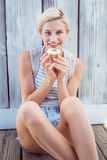 Pretty blonde woman holding cupcake Royalty Free Stock Photos
