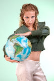 Pretty blonde woman holding globe of world Royalty Free Stock Photography