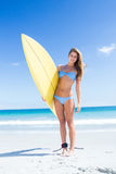 Pretty blonde woman holding surf board Royalty Free Stock Photo