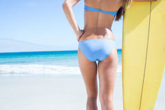 Pretty blonde woman holding surf board Royalty Free Stock Image