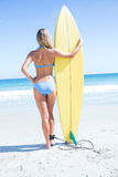 Pretty blonde woman holding surf board Stock Image