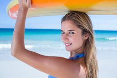 Pretty blonde woman holding surf board Royalty Free Stock Photography