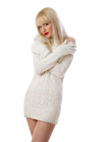 Pretty blonde woman in knitted dress Royalty Free Stock Image
