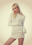 Pretty blonde woman in knitted dress Royalty Free Stock Images