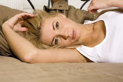 Pretty blonde woman laying in bed, sensual Royalty Free Stock Photo