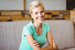 Pretty blonde woman looking at camera with arms crossed Stock Photography
