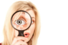 Pretty Blonde Woman with Magnifying Glass Royalty Free Stock Photos